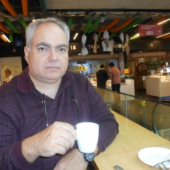 Husband enjoying a coffee at Mercado San Anton